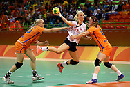 RIO DE JANEIRO, BRAZIL - AUGUST 20:  Stine Bredal Oftedal of Norway takes a shot under pressure of Danick Snelder (L) and Laura van der Heijden of Netherlands during the Women's Handball Bronze medal match between Netherlands and Norway at Future Arena on Day 15 of the Rio 2016 Olympic Games at the Future Arena on August 20, 2016 in Rio de Janeiro, Brazil.  (Photo by Elsa/Getty Images)