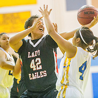 Crownpoint Eagle Tia Charley (42), left, and  Zuni Thunderbird Alanee Esalio (4) tie up for possesion at Zuni High School Tuesday.