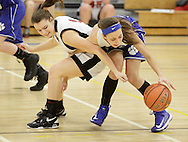 Wallkill's Chelsea Murphy, right, keeps the ball away from Onteora's Stephanie Smith during the Mid-Hudson Athletic League girls' basketball championship game at Ulster County Community College in Stone Ridge on Thursday, Feb. 21, 2013.