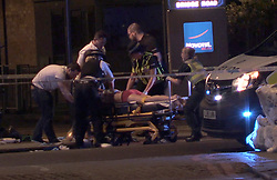 Screengrab taken from PA Video footage of people receiving medical attention in Thrale Street near London Bridge following a terrorist incident.