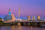 Canadian Museum for Human Rights (CMHR) and the Esplanade Riel Bridge and the Red River at dawn<br /> Winnipeg<br /> Manitoba<br /> Canada