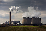 Smoke and steam bellows from the chimneys and cooling towers of Ratcliffe-on-Soar power station