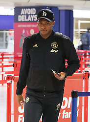 Antonio Valencia is spotted on his way to catch a flight as the team fly to Turin on Tuesday afternoon to play Juventus in The Champions League on Wednesday night.