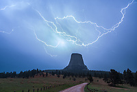 I wasn't expecting to be back at Devil's Tower so soon but this was an opportunity I just couldn't pass up. I spent the evening chasing a supercell past the tower to the Montana border where it dropped hail larger than golf balls. Then I headed back to the tower just in case any new storms popped up. When I got there, lightning was beginning to flash from a new thunderstorm to the west, just like I had hoped. When rain began to fall I went and stood under the back door of my car to shoot pictures. The lightning wasn't all that frequent and it was challenging to get the exposure right. In between flashes, the light level would go from pitch black to practically burning my retina. When the rain let up a little, I went and stood in the middle of the dirt road. That's when this bolt filled the sky, perfectly placed above the tower. It's certainly the best foreground I've ever had for a lightning picture and I may have cheered after it happened.
