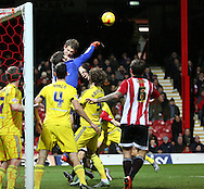 Middlesbrough goalkeeper Dimitrios Konstantopoulos getting a facefull off Brentford defender James Tarkowski during the Sky Bet Championship match between Brentford and Middlesbrough at Griffin Park, London, England on 12 January 2016. Photo by Matthew Redman.