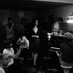 """The New York band Elysian Fields playing at a Blogotheque's """"Soiree de Poche"""" (pocket night) in a private appartement in Paris, France. 24 May 2010. Photo: Antoine Doyen"""