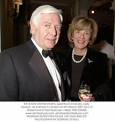MR & MRS STEPHEN RUBIN, parents of Amanda, Lady Harlech, at a dinner in London on 5th March 2001.OLU 10