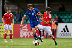 RHYL, WALES - Monday, September 4, 2017: Wales' Robbie Burton and Iceland's Stefan Alexander Ljubicic during an Under-19 international friendly match between Wales and Iceland at Belle Vue. (Pic by Paul Greenwood/Propaganda)
