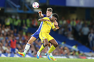 Gary Cahill of Chelsea challenges  Ellis Harrison of Bristol Rovers. EFL Cup 2nd round match, Chelsea v Bristol Rovers at Stamford Bridge in London on Tuesday 23rd August 2016.<br /> pic by John Patrick Fletcher, Andrew Orchard sports photography.