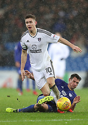 Cardiff City's Craig Bryson and Fulham's Tom Cairney (left) battle for the ball