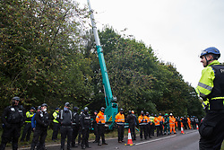 Wendover, UK. 10th October, 2021. Enforcement agents from the National Eviction Team (NET), working alongside Thames Valley Police officers, commence works to evict environmental activists opposed to the HS2 high-speed rail link from Wendover Active Resistance (WAR) camp. WAR camp, which contains tree houses, tunnels, a cage and a 15-metre tower, is currently the largest of the protest camps set up by Stop HS2 activists along HS2's Phase 1 route between London and Birmingham.