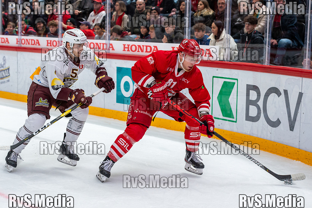 LAUSANNE, SWITZERLAND - NOVEMBER 23: #81 Ronalds Kenins of Lausanne HC battles for the puck with #52 Mike Vollmin of Geneve-Servette HC during the Swiss National League game between Lausanne HC and Geneve-Servette HC at Vaudoise Arena on November 23, 2019 in Lausanne, Switzerland. (Photo by Monika Majer/RvS.Media)