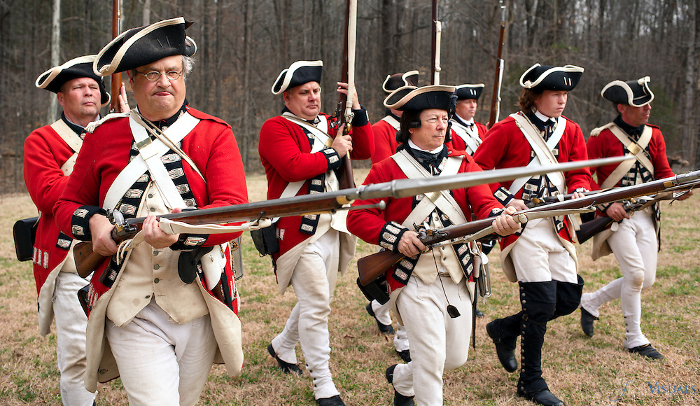 Mark Dappert, left, drills with members of the 7th Regiment of Foot (Royal Fusiliers) as they prepare for battle.<br /> <br /> Over 300 Revolutionary War reenactors from across the country mustered in Greensboro on March 12 &13 for the Battle of Guilford Courthouse, which originally occurred on March 15, 1781. The reenactment attracts hundreds of participants and thousands of onlookers to see a live recreation of the original battle and life in the combatants camps. American and British troops fire on each other with cannons and flintlock muskets as they advance toward each other on the rolling fields of Country Park in Greensboro, NC, the county seat of Guilford County. During the American Revolutionary War a 2,100-man British force under the command of Lieutenant General Charles Cornwallis defeated Major General Nathanael Greene's 4,500 Americans. The British Army, however, lost a considerable number of men during the battle with estimates as high as 27%. Such heavy British casualties resulted in a strategic victory for the Americans.<br /> <br /> JERRY WOLFORD / Perfecta Visuals