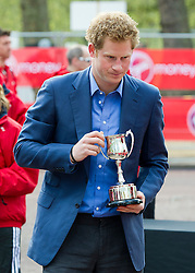 © London News Pictures. 22/04/2012. London, UK. HRH Prince Harry presenting awards to the winners of the Mini Marathon event before the 2012 Virgin London Marathon on April 22, 2012. Photo credit : Ben Cawthra /LNP