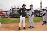 CHICAGO - October 5:  Manager Ozzie Guillen #13 (L) of the Chicago White Sox greets Tampa Bay Rays manager Joe Maddon prior to the game against the Tampa Bay Rays at U.S. Cellular Field in Chicago, Illinois on October 5, 2008.  The White Sox defeated the Rays 5-3.  (Photo by Ron Vesely)