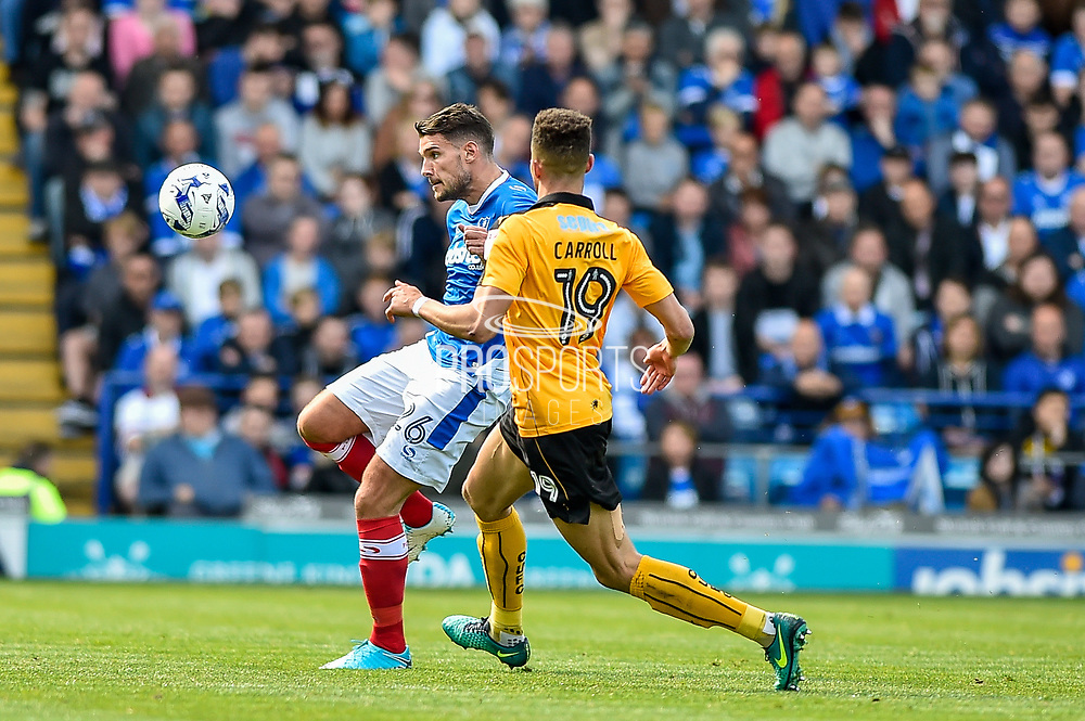 Portsmouth Midfielder, Gareth Evans (26) beats Cambridge United Defender, Jake Carroll (19) to the ball during the EFL Sky Bet League 2 match between Portsmouth and Cambridge United at Fratton Park, Portsmouth, England on 22 April 2017. Photo by Adam Rivers.
