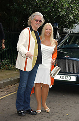 Comedian BILLY CONNOLLY and his wife PAMELA STEPHENSON at Sir David & Lady Carina Frost's annual summer party held in Carlyle Square, Chelsea, London on 5th July 2006.<br />