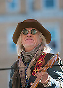 05 November 2012:  Aerosmith's Brad Whitford with refelection of his old apartment building in his sunglasses during a free concert in Boston's Allston neighborhood in front of the apartment building, 1325 Commonwealth Ave, which was the band's home in the early 1970's.  Boston, MA. ***Editorial Use Only*****