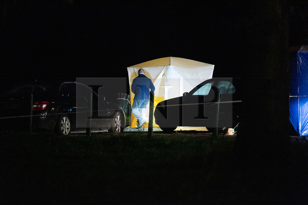 © Licensed to London News Pictures. 19/12/2019. London, UK. A police forensic tent is placed over a vehicle in Scratchwood Park carpark after a man died of stab injuries. Police were called to Courtland Avenue, NW7, at 20:11GMT following a report of a fight in progress. Officers attended however no trace of any victim or suspects was found. At 20.27GMT, police were called by the London Ambulance Service to Barnet Bypass, near Scratchwood Park, to reports of a man, in his 20s, with stab injuries. Officers attended. The man was treated at the scene by paramedics before being taken to hospital. After a search of a car found at the scene, a man, in his 30s, was found inside a vehicle with stab wounds. Despite the efforts of emergency services, he was declared dead a short time later. Photo credit: Peter Manning/LNP