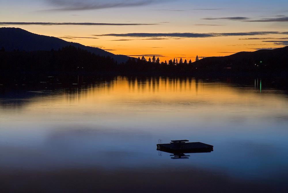 Floating dock on Oregon's Wallowa Lake at dusk.