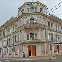 Ornate tile buildings hint at the wealth built by some during the rubber boom in Iquitos, Peru.