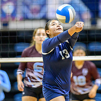 Window Rock Scout Sonja Ayze  (13) reverse volleys to the Ganado Hornets at the Fighting Scout Event Center in Fort Defiance Tuesday.