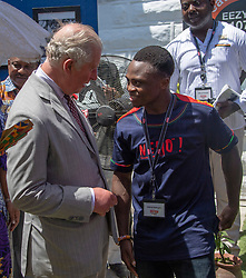 While watching a football practise the Duchess batted away the football with her giant fan The Prince of Wales and The Duchess of Cornwall attended an Art, Music, Dance and Youth Exhibition at Jamestown, Accra Their Royal Highnesses were greeted by The Minister of Sport, Honourable Isaac Asiamah, The Second Lady of Ghana. The Prince and The Duchess viewed James Barnor photography exhibition, and met Boxers Azumah Nelson, and Isaac Dogboe, and viewed a sports demonstration. and met Shatta Wale, a leading musician in Ghana with a global following. His Royal Highness was invited to take a seat and watch a performance by the young D.J. Switch, including choreography by the dancers and roller skaters from the Performance for Action Team. Pic Arthur Edwards