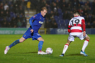 AFC Wimbledon midfielder Mitchell (Mitch) Pinnock (11) dribbling and taking on Doncaster Rovers attacker Alfie May (19) during the The FA Cup match between AFC Wimbledon and Doncaster Rovers at the Cherry Red Records Stadium, Kingston, England on 9 November 2019.