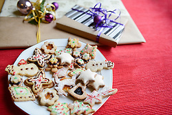 Christmas homemade gingerbread cookies in plate and gift boxes, Bavaria, Germany