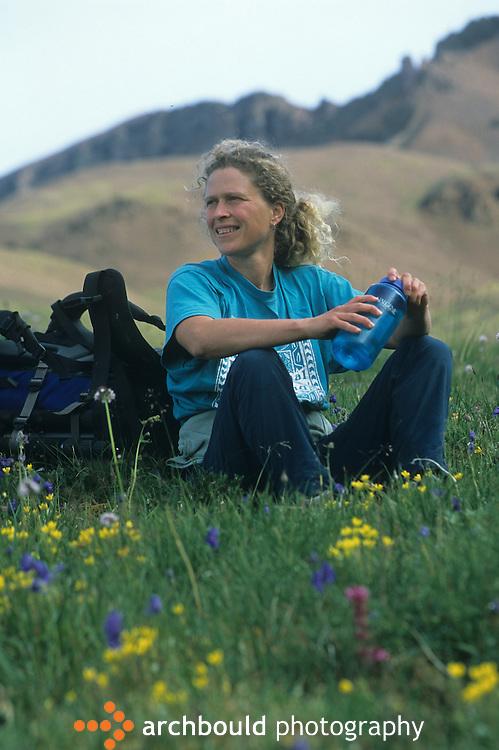 Woman taking a rest on Donjek Glacier hike in Kluane National Park