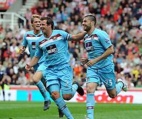 Fotball<br /> England<br /> Foto: Fotosports/Digitalsport<br /> NORWAY ONLY<br /> <br /> Stoke City v West Ham United 02/05/2009 Premier League<br /> Diego Tristan  (West Ham) celebrates first goal with Lucas Neill