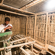 CAPTION: Mohammad Irshad loads wheat for milling by machinery powered by energy derived from biomass. LOCATION: Bara, Araria District, Bihar, India. INDIVIDUAL(S) PHOTOGRAPHED: Mohammad Irshad.