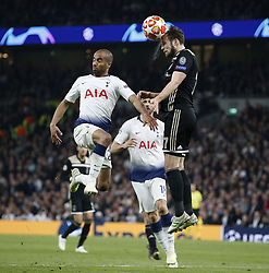 BRITAIN-LONDON-FOOTBALL-UEFA CHAMPIONS LEAGUE-TOTTENHAM HOTSPUR VS AJAX.(190430) -- LONDON, April 30, 2019  Ajax's Daley Blind (R) heads the ball under pressure from Tottenham Hotspur's Lucas Moura (L) during the UEFA Champions League Semifinal First Leg match between Tottenham Hotspur and Ajax at The Tottenham Hotspur Stadium in London, Britain on April 30, 2019. Ajax won 1-0.  FOR EDITORIAL USE ONLY. NOT FOR SALE FOR MARKETING OR ADVERTISING CAMPAIGNS. NO USE WITH UNAUTHORIZED AUDIO, VIDEO, DATA, FIXTURE LISTS, CLUB/LEAGUE LOGOS OR ''LIVE'' SERVICES. ONLINE IN-MATCH USE LIMITED TO 45 IMAGES, NO VIDEO EMULATION. NO USE IN BETTING, GAMES OR SINGLE CLUB/LEAGUE/PLAYER PUBLICATIONS. (Credit Image: © Matthew Impey/Xinhua via ZUMA Wire)