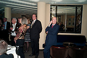 STEPHEN FRY; CHARLES MOORE, Graydon Carter hosts a dinner to celebrate the reopening og the American Bar at the Savoy.  Savoy Hotel, Strand. London. 28 October 2010. -DO NOT ARCHIVE-© Copyright Photograph by Dafydd Jones. 248 Clapham Rd. London SW9 0PZ. Tel 0207 820 0771. www.dafjones.com.