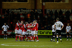 Bristol City look dejected as Crewe Alexandra players celebrate after Jamie Ness scores a goal to make it 1-0 - Photo mandatory by-line: Rogan Thomson/JMP - 07966 386802 - 20/12/2014 - SPORT - FOOTBALL - Crewe, England - Alexandra Stadium - Crewe Alexandra v Bristol City - Sky Bet League 1.