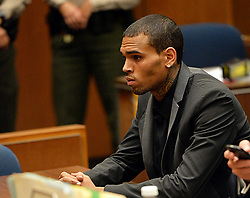 July 15, 2013 - Los Angeles, California, U.S - R&B singer Chris Brown appears during a court hearing at Los Angeles Superior court in Los Angeles Monday, July 15, 2013. A Los Angeles judge has revoked Chris Brown's probation after reading details of an alleged hit-and-run accident and his behavior afterward, but the singer was not ordered to jail. The prosecutor did not ask for Brown to be jailed. Another hearing is set for Aug. 16.  The singer has been on felony probation in the 2009 beating of former girlfriend Rihanna. (Credit Image: © Prensa Internacional/ZUMAPRESS.com)