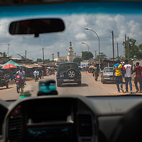Travelling through Agboville, Ivory Coast. The mosque of Abvoville is in the background.