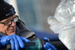 © Licensed to London News Pictures.10/01/2013. London, UK. A member of team Sweden creates an ice sculpture during the single block ice-sculpting competition at the London Ice Sculpting Festival in Canary Wharf.. Photo credit : Peter Kollanyi/LNP