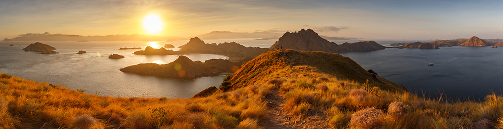 Panoramic sunset from high ridge viewing the islands and waterways of Komodo National Park
