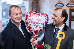 © Licensed to London News Pictures . 14/02/2017 . Stoke-on-Trent , UK . Lib Dem leader TIM FARRON with candidate DR ZULFIQAR ALI , with a Happy Valentine's Day balloon , at the Liberal Democrat by-election base in the Wheatsheaf Pub on Sheaf Street , campaigning in the Stoke Central by-election . Photo credit : Joel Goodman/LNP