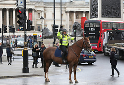 Mounted police in Trafalgar Square, London, after policeman has been stabbed and his apparent attacker shot by officers in a major security incident at the Houses of Parliament.
