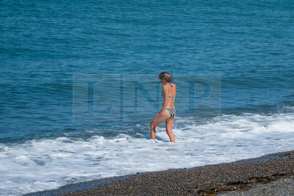 © Licensed to London News Pictures<br /> 02 July 2018 . Aberystwyth Wales UK<br /> <br /> UK Weather:  People head to the seaside in Aberystwyth as the scorchingly hot  and very dry weather continues to dominate the UK.<br /> After a brief respite overnight, with some light rain, the searing heat has returned , with temperatures  again rising to the low 30º's this week<br /> <br /> photo creditKeith Morris / LNP