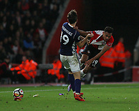 Football - 2017 / 2018 Premier League - Southampton vs. West Bromwich Albion<br /> <br /> Southampton's Sofiane Boufal and Jay Rodriguez of West Bromwich Albion tussle after the ball has gone at St Mary's Stadium Southampton<br /> <br /> COLORSPORT/SHAUN BOGGUST