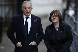 © Licensed to London News Pictures. 12/11/2017. London, UK. Former Prime Minister Tony Blair and his wife Cherie walk through Downing Street to attend the Remembrance Sunday Ceremony at the Cenotaph in Whitehall. Photo credit: Peter Macdiarmid/LNP