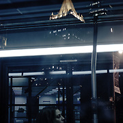Reflection of a girl in the bus by night.