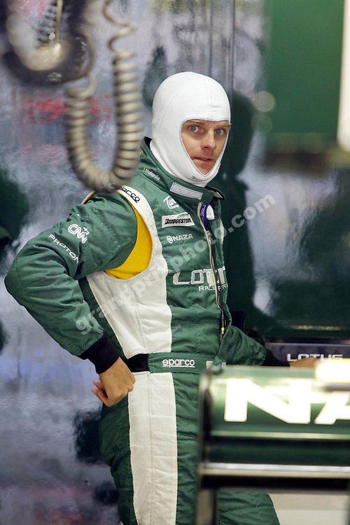 Heikki Kovalainen (Lotus-Cosworth) in the pits with his balaclava on during practice for the 2010 German Grand Prix in Hockenheim. Photo: Grand Prix Photo