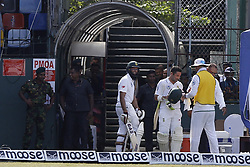 July 22, 2018 - Colombo, Sri Lanka - South African cricket team's opening batsman  Dean Elgar ( holding a  green colored  Head Gear  ) retrieves his gloves from a fellow South African cricketer on his way back to the ground from the dressing room following a reversing of on-field umpire decision to not-out after 3rd Umpire revealed the bowler, Sri Lankan cricketer DIlruwan Perera (unseen) had over-stepped while South African cricketer Hashim Amla smiles   during the 3rd day's play in the 2nd test cricket match between Sri Lanka and South Africa at SSC International Cricket ground, Colombo, Sri Lanka on Sunday  22 July 2018  (Credit Image: © Tharaka Basnayaka/NurPhoto via ZUMA Press)