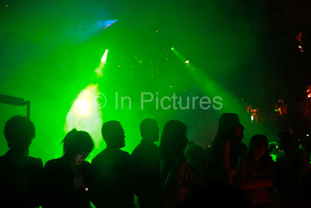 Club goers dance at the popular M2 club in Shanghai, China on Oct. 14, 2011.  The city's clubs are popular among affluent youth as well as expatriates.