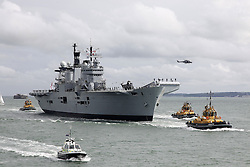 © Licensed to London News Pictures. File pic dated 07/07/2011. London, UK. HMS Illustrious returning to Portsmouth in July 2011. The government has announced that HMS Illustrious is heading to the Philippines to help with the Typhoon Haiyan recovery efforts. Photo credit : Bryan Moffat/LNP