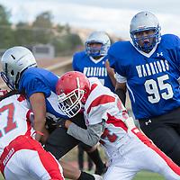 Pine Hill defenders Maynard Alonzo (47) and Shawndel Nez (24), sack Warriors quarterback Dempsey Lincoln (13), in Navajo on Saturday.